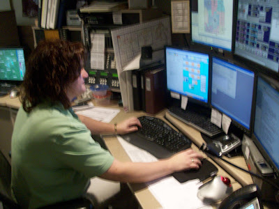 911 Telecommunicator Sandy Lovetinsky at her post in the Washington County Communications Center (KCII-News)