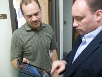 WCSD Technology Director Jeff Brock (Left) shows WHS Principal Shane Ehresman a few things on the iPad (KCII NEWS)