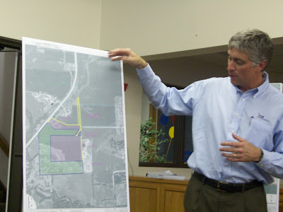 Scott Renaud of Fox Engineering points out the likely path of the new sewer line (KCII NEWS)