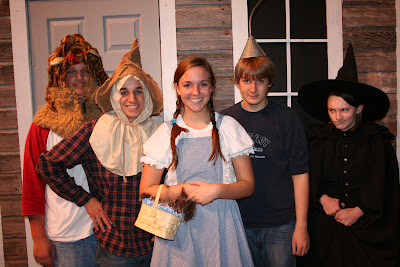 Left to right:  Cowardly Lion (Michael Darby), Scarecrow (Will Dehogues), Dorothy (Katie Nisly), TinMan (Sam Swartzendruber), Wicked Witch of the West (Aliese Gingerich). (Photo Submitted by IMS)