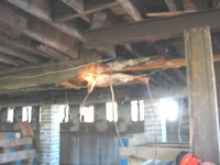 The main support beam for the building is rotted and severely damaged.<br />