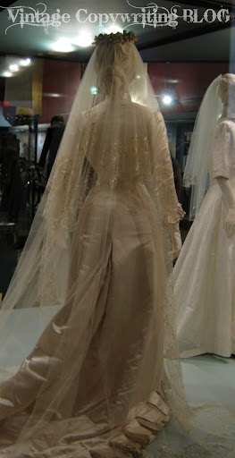 The dress is cream satin a very expensive bridal gown