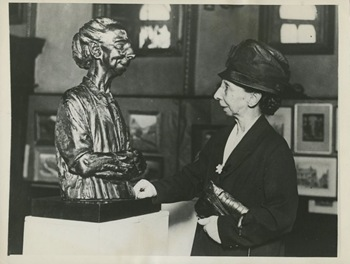 Miss Sarah Dover looking at the statue of herself 1931