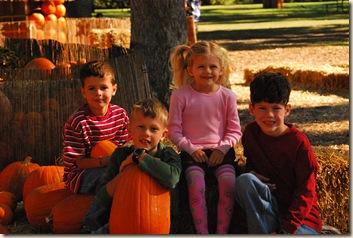 4 smiling kids