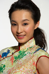 Asian woman in traditional clothing.