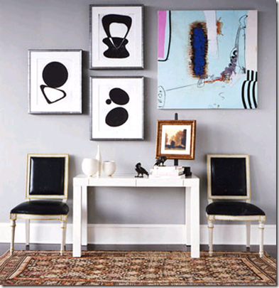 I Like How The Square Painting Is Balanced Out With Smaller Pieces Of Art.  Via Domino Magazine.