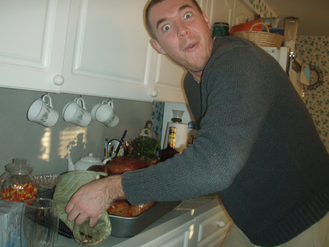 Excitedly pulling out the Wink/Dolan family turkey on Thanksgiving 2008.