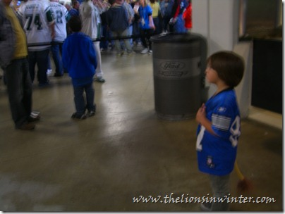Sad little Lions fan watching the Jets fans congregate.