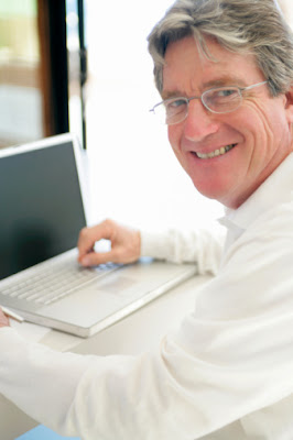 An elderly man applying for installment loans for bad credit online.
