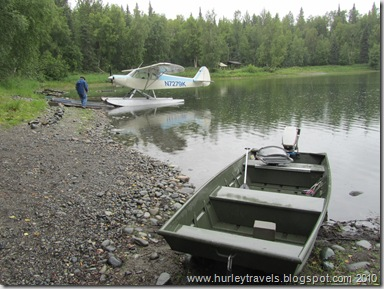 Private plane and fishing boat on Christiansen Lake near Talkeetna, AK.