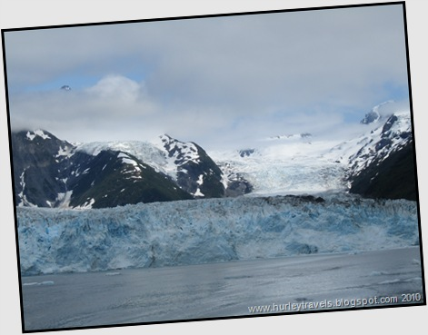 This shows just a portion of the 100 foot high wall of the Meares Glacier as it extends into the water.