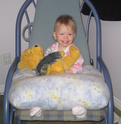 Putting Pooh Bear down for a nappy