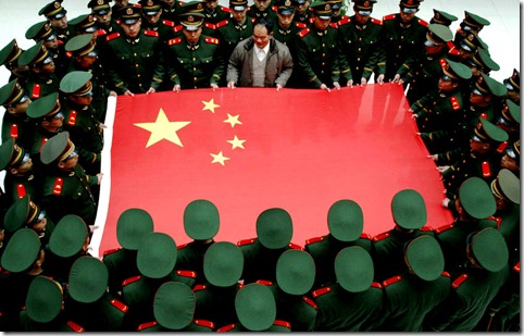 China Flag Held by Soldiers