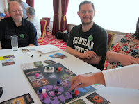 Players and a 'hand' during a game of Shadow Hunters