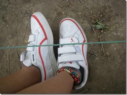white sneakers vs dark legs