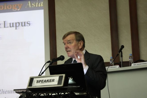 Professor Graham Hughes delivering his opening message on Ten Topics in Rheumatology Asia