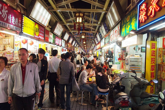 The Xiaochi or street food area in Snake Alley night market, Taipei, Taiwan