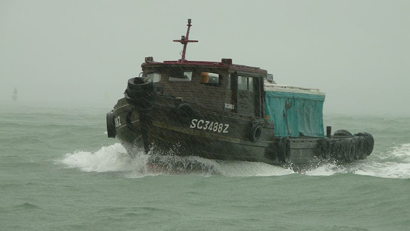 Bumboat in rain