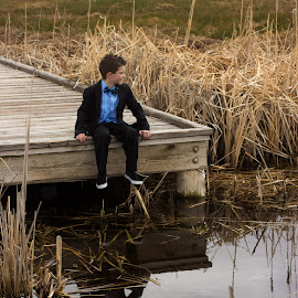 Dock by Jeremy Johnsen - Babies & Children Child Portraits ( child, reflection, formal, wood, suit, path, boy, reeds )