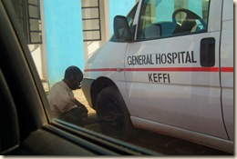 police man deflating ambulance tire