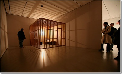 Performance 1: Tehching Hsieh, at the Museum of Modern Art, displays a wooden cage like one in which the artist spent a year, doing nothing. Chester Higgins Jr./The New York Times