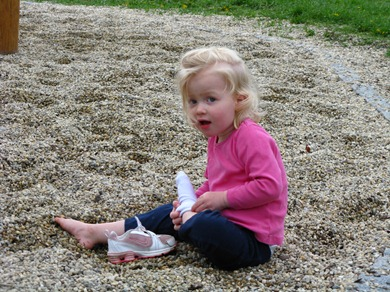 On the playground after school at BIS, Alexandra LOVES to take her socks & shoes off ever since we were in the sun in Italy!