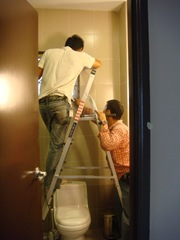 Fixing the security grille to the master bathroom