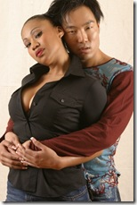 Black woman and Asian man embrace
