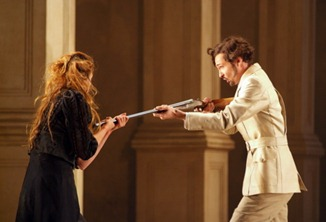 Christophe Dumaux as Tolomeo in Händel's GIULIO CESARE at the Opéra de Lille, with Charlotte Hellekant as Cornelia [Photo by Frédéric Iovino]
