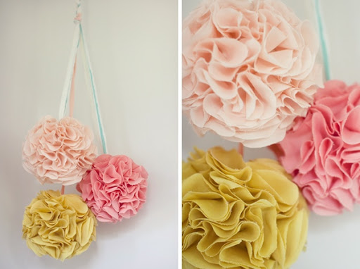 Combine circles of fabric chinese lanterns and hot glue to make these