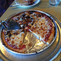 Amazing gf pizza! Baked in separate container so it doesn't touch grill!