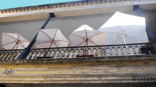 Sun umbrellas in a small café in the Pasaje de la Defensa in San Telmo in Buenos Aires, Argentina
