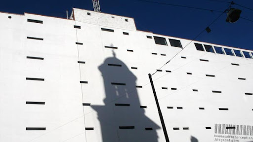 Fascinating play of light and shadow on blank car park wall in Buenos Aires