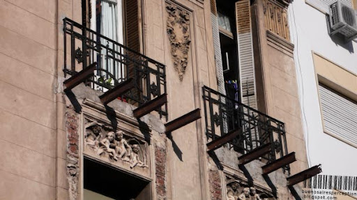 Bare Steel Beams, Remains of a Balcony in an old Building Facade in Buenos Aires, Argentina