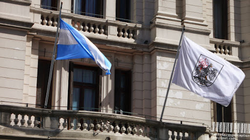 The City Flag of the Autonomous City of Buenos Aires together with the National Flag of Argentina