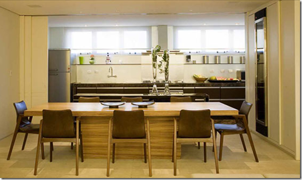 Sala de jantar aberta por Silvana Mattar