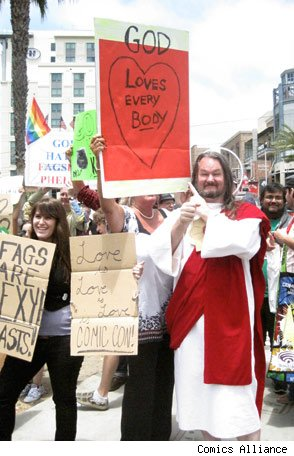 Jesus costume and GOD LOVES EVERYBODY sign