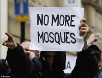 Protester with 'NO MORE MOSQUES' sign