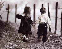 Little boy and girl hold hands