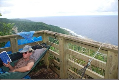 Jason strings up a hammock at the overlook on 'Eua