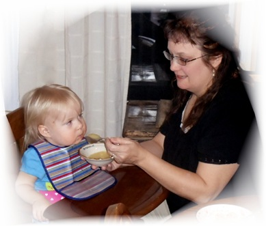 Grandma feeds Lena
