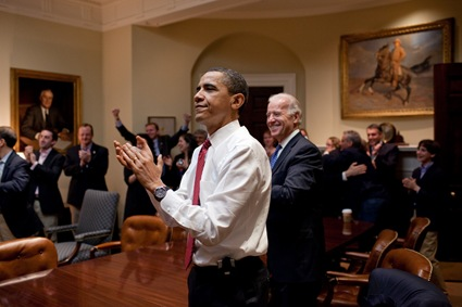 President Barack Obama, Vice President Joe Biden, and senior staff applaud in the Roosevelt Room of the White House, as the House passes the health care reform bill, March 21, 2010. (Official White House Photo by Pete Souza)
