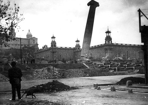 The demolition of <a href='http://en.wikipedia.org/wiki/The_Four_Columns'>Puig i Cadafalch's symbolic four columns</a> in 1928, CC from <a href='http://commons.wikimedia.org/wiki/File:Catalunya-Barcelona-EnderrocamentColumnesMontjuic.jpg'>Wikimedia Commons</a>