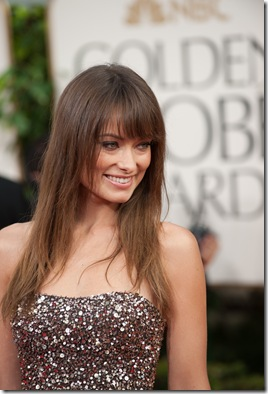 Olivia Wilde attends the 68th Annual Golden Globes Awards at the Beverly Hilton in Beverly Hills, CA on Sunday, January 16, 2011. ++ FASHION TAGS ++ Olivia Wilde: Marchesa gown black tulle with antique gold sequin strapless bodice, Christian Louboutin heels