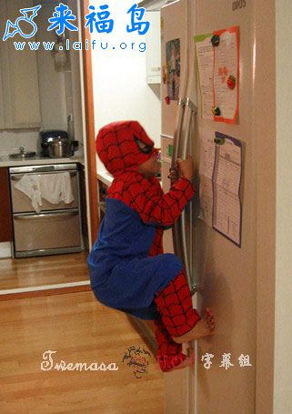 15 reasons why boys need strict parents - Baby boy spiderman on a refrigerator