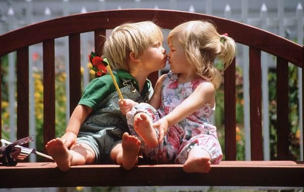 15 reasons why boys need strict parents - Baby boy kissing a baby girl