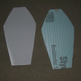 Thigh armor - polystyrene sheet to cover a foam sheet.  The grooves in the foam let me curve it along its length.