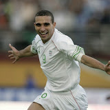 Algeria's Djebbour Rafik celebrates after the team scored against Liberia during their African Zone World Cup 2010 qualifying soccer match in Blida June 6, 2008. REUTERS/Louafi Larbi (ALGERIA)