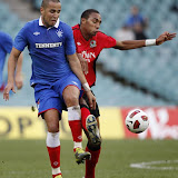 Madjid Bougherra of Glasgow Rangers FC (L) battles with Steven N'Zonzi of Blackburn Rovers FC during their soccer match as part of the Sydney 2010 Festival of <a href='http://football.endz.co.cc/'>Football</a> at Sydney <a href='http://football.endz.co.cc/'>Football</a> Stadium July 25, 2010. REUTERS/Daniel Munoz (AUSTRALIA - Tags: SPORT SOCCER)