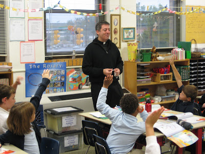 Fr. John teaches a lesson about the rosary